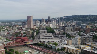 DX0001_000286 - 5.7K stock footage aerial video flying over condominiums toward downtown skyscrapers, sunset, Downtown Portland, Oregon