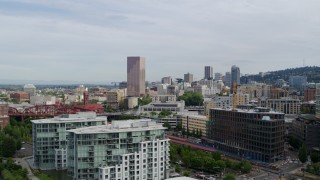 DX0001_000287 - 5.7K stock footage aerial video of fly away from downtown to reveal condominiums and factory water tower, sunset, Downtown Portland, Oregon
