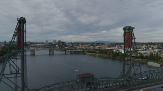 DX0001_000288 - 5.7K stock footage aerial video flying over the Hawthorne Bridge and Willamette River, sunset, Southeast Portland, Oregon