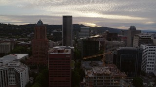 DX0001_000303 - 5.7K stock footage aerial video side view of Downtown Portland office buildings and skyscrapers at sunset, Oregon