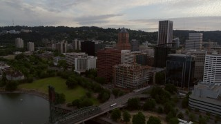 DX0001_000308 - 5.7K stock footage aerial video approaching office buildings and KOIN Center, twilight, Downtown Portland, Oregon