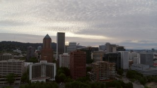 DX0001_000309 - 5.7K stock footage aerial video flying away from downtown office buildings at twilight, Downtown Portland, Oregon