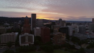 DX0001_000317 - 5.7K stock footage aerial video approaching and flying by the downtown skyline at twilight in Downtown Portland, Oregon