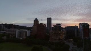 DX0001_000318 - 5.7K stock footage aerial video descending over the Willamette River with a view of Downtown Portland, Oregon at twilight