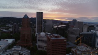 DX0001_000321 - 5.7K stock footage aerial video flying by office buildings and skyscrapers in Downtown Portland, Oregon at sunset