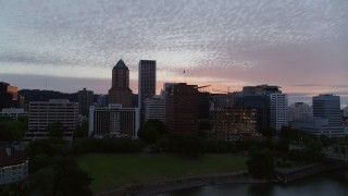 DX0001_000325 - 5.7K stock footage aerial video flying across the river toward the Downtown Portland, Oregon skyline at twilight