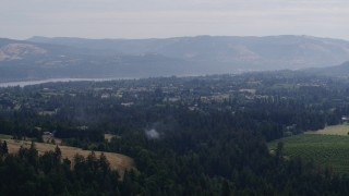 DX0001_000361 - 5.7K stock footage aerial video of a small town by a river in Hood River, Oregon