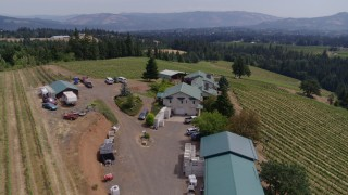 DX0001_000425 - 5.7K stock footage aerial video of flying over buildings and hillside grapevines at Phelps Creek Vineyards in Hood River, Oregon