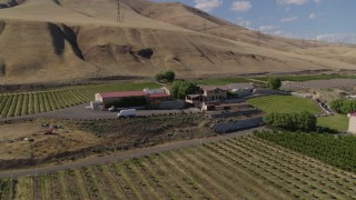 DX0001_000437 - 5.7K stock footage aerial video of passing by the Maryhill Winery, amphitheater, and vineyards in Goldendale, Washington