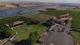 DX0001_000438 - 5.7K stock footage aerial video orbit the Maryhill Winery, amphitheater, and vineyards beside the Columbia River in Goldendale, Washington