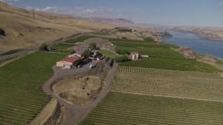 DX0001_000440 - 5.7K stock footage aerial video of a reverse view of the Maryhill Winery and vineyards beside the Columbia River in Goldendale, Washington