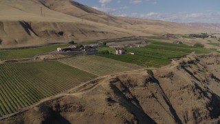 DX0001_000441 - 5.7K stock footage aerial video of a view of the Maryhill Winery and vineyards from a cliff in Goldendale, Washington