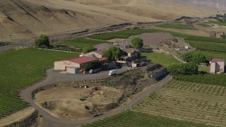 DX0001_000453 - 5.7K stock footage aerial video of approaching buildings at the Maryhill Winery in Goldendale, Washington