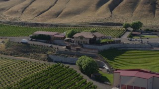 DX0001_000456 - 5.7K stock footage aerial video of flying around the buildings and amphitheater at the Maryhill Winery in Goldendale, Washington