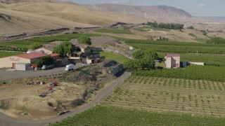 DX0001_000468 - 5.7K stock footage aerial video of flying by the Maryhill Winery and amphitheater in Goldendale, Washington