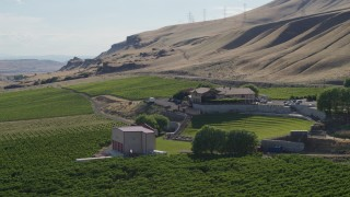 DX0001_000471 - 5.7K stock footage aerial video of flying around the Maryhill Winery and amphitheater, reveal Columbia River in Goldendale, Washington
