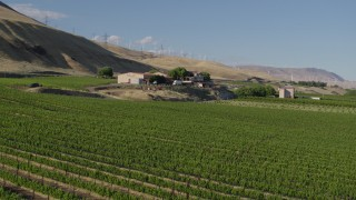 DX0001_000473 - 5.7K stock footage aerial video of a low altitude approach and flyby of the Maryhill Winery in Goldendale, Washington
