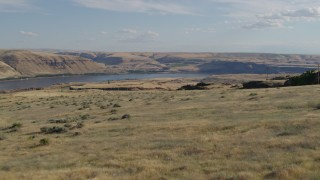 DX0001_000491 - 5.7K stock footage aerial video fly over cliff toward Miller Island and the Columbia River in Goldendale, Washington