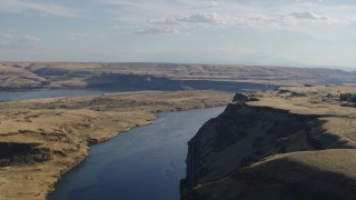 DX0001_000492 - 5.7K stock footage aerial video of Miller Island and the Columbia River seen from the edge of a cliff in Goldendale, Washington