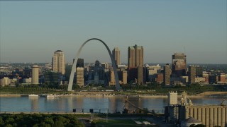 DX0001_000519 - 5.7K stock footage aerial video flying over park near grain elevator approaching the Arch and skyline, sunrise, Downtown St. Louis, Missouri