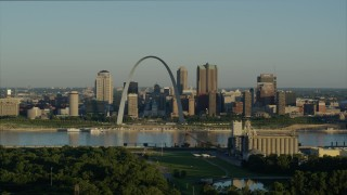 DX0001_000520 - 5.7K stock footage aerial video reverse shot of the Arch and skyline seen from a park across the Mississippi River, sunrise, Downtown St. Louis, Missouri