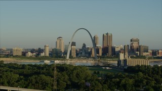 DX0001_000523 - 5.7K stock footage aerial video ascending over park toward Mississippi River, Arch and skyline at sunrise, Downtown St. Louis, Missouri