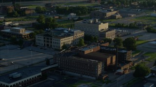 DX0001_000526 - 5.7K stock footage aerial video orbiting a federal courthouse and medical center, sunrise, East St. Louis, Illinois