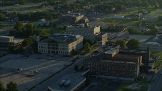 DX0001_000527 - 5.7K stock footage aerial video circling a federal courthouse and hospital at sunrise, East St. Louis, Illinois