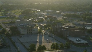 DX0001_000528 - 5.7K stock footage aerial video orbit a medical center and a federal courthouse, sunrise, East St. Louis, Illinois
