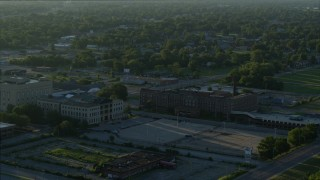 DX0001_000529 - 5.7K stock footage aerial video orbiting a medical center and federal courthouse at sunrise, East St. Louis, Illinois
