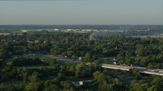 DX0001_000533 - 5.7K stock footage aerial video descending from a view of a residential fire, sunrise, East St. Louis, Illinois