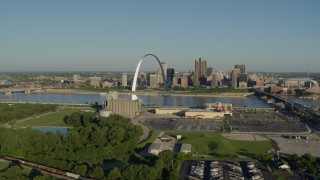 DX0001_000539 - 5.7K stock footage aerial video of the Arch and skyline seen from across the Mississippi River, sunrise, Downtown St. Louis, Missouri