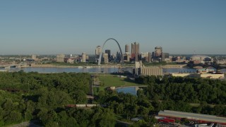 DX0001_000546 - 5.7K stock footage aerial video of ascending over freeway toward park in East St. Louis with views of skyline and Arch, sunrise, Downtown St. Louis, Missouri