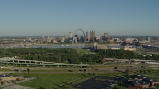 DX0001_000549 - 5.7K stock footage aerial video of freeway and park in East St. Louis, looking toward Arch and skyline, sunrise, Downtown St. Louis, Missouri