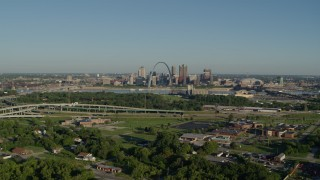 DX0001_000550 - 5.7K stock footage aerial video wide angle of skyline and Arch from interstate and park, sunrise, Downtown St. Louis, Missouri