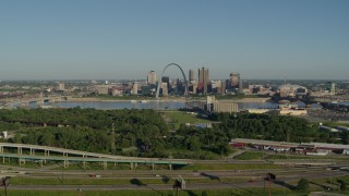 DX0001_000552 - 5.7K stock footage aerial video of skyline and Arch from freeway and park in East St. Louis, sunrise, Downtown St. Louis, Missouri