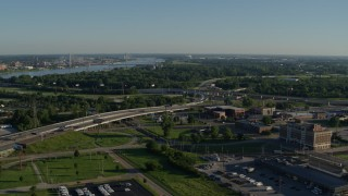DX0001_000554 - 5.7K stock footage aerial video of freeways and a police station with views of a river, sunrise, East St Louis, Illinois