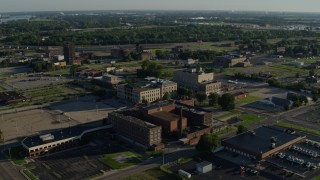 DX0001_000555 - 5.7K stock footage aerial video of a federal courthouse and medical center in a small town, sunrise, East St Louis, Illinois
