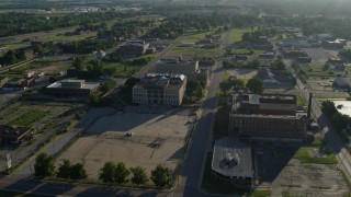 DX0001_000558 - 5.7K stock footage aerial video of hospital and government buildings at sunrise, East St Louis, Illinois