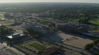 DX0001_000559 - 5.7K stock footage aerial video wide angle of a federal courthouse and abandoned hospital, sunrise, East St Louis, Illinois