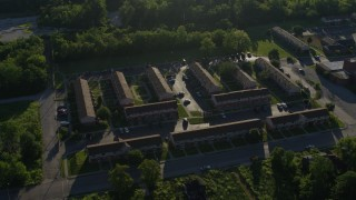 DX0001_000562 - 5.7K stock footage aerial video of low income apartment buildings, sunrise, East St Louis, Illinois