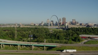 DX0001_000565 - 5.7K stock footage aerial video descending below freeways with skyline and Arch in the distance, Downtown St. Louis, Missouri
