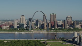 DX0001_000567 - 5.7K stock footage aerial video of a grain elevator ascending to show the Gateway Arch and its museum, Downtown St. Louis, Missouri