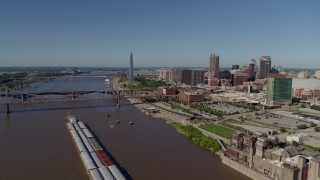 DX0001_000577 - 5.7K stock footage aerial video flying over Mississippi River with barges near Downtown St. Louis, Missouri