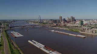 DX0001_000579 - 5.7K stock footage aerial video reverse of barges and the Mississippi River near Downtown St. Louis, Missouri