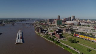 DX0001_000583 - 5.7K stock footage aerial video flyby riverfront buildings and river barge in Downtown St. Louis, Missouri
