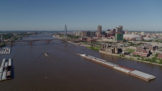 DX0001_000584 - 5.7K stock footage aerial video of a view of riverfront buildings and barges on the river, Downtown St. Louis, Missouri