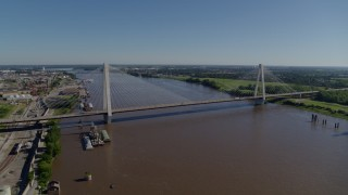 DX0001_000589 - 5.7K stock footage aerial video reverse from cable-stayed bridge spanning the Mississippi River revealing barges, St. Louis, Missouri
