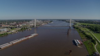 DX0001_000590 - 5.7K stock footage aerial video of a reverse of barges on the river and a cable-stayed bridge, St. Louis, Missouri