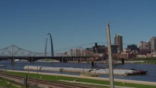 DX0001_000617 - 5.7K stock footage aerial video of the Gateway Arch and bridge across the river, Downtown St. Louis, Missouri